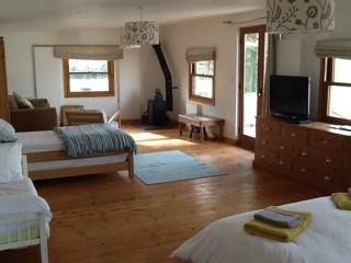 woodburner, sitting area, beds for 4 + infants